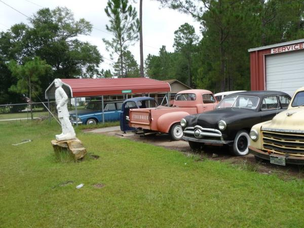 Studebakers By Statue