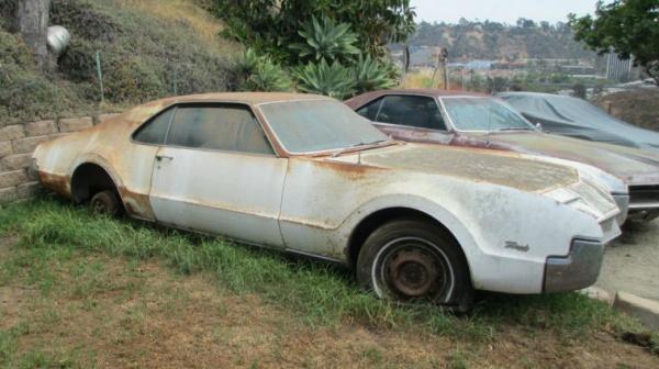 rust-covered-1966-oldsmobile-toronado-side-view