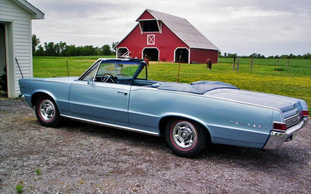Pontiac Tempest in front of barn