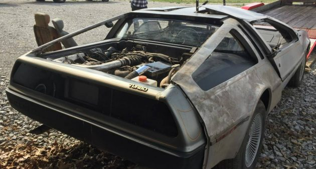 Wrecked Gullwings: DeLorean Project Pair