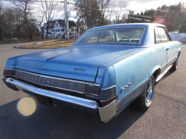 rust-goat-1965-pontiac-gto-rear-corner
